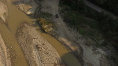 Aerial view over an Off-road vehicle crossing a river in speed. - stock footage