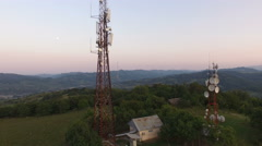 Aerial view over Cellphone radio telecommunication tower - stock footage