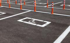 Parking space reserved for handicapped shoppers in a retail parking lot Stock Photos