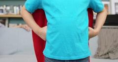 Little boy pretending to be superhero Stock Footage
