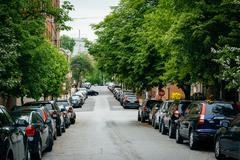 A tree-lined street in Federal Hill, Baltimore, Maryland. Stock Photos