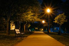 Bench and walkway at Federal Hill Park at night, in Baltimore, Maryland. Stock Photos