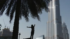Woman in front of the tallest building in the world Stock Footage