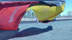 Little girl running under big kite Stock Footage