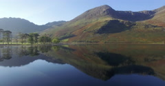 Lake Buttermere pines and peaks of High Crags, Lake District National Park Stock Footage