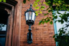 Lamp affixed to a house in Mount Vernon, Baltimore, Maryland. Stock Photos