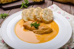 Chicken on cream with pepper season - stock photo