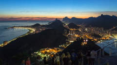 Tourists viewing Christ the Redeemer and the city of Rio de Janeiro at sunset Stock Footage