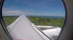 Plane landing on runway, out of porthole window Stock Footage