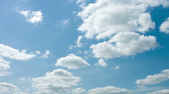 Timelapse with white fluffy clouds over blue sky. Nature background Stock Footage