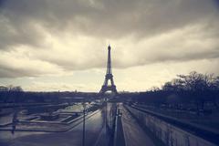 Photo of Eiffel Tower with dramatic sky, Paris, France Stock Photos