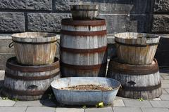 Old wooden buckets or barrel for exterior - stock photo