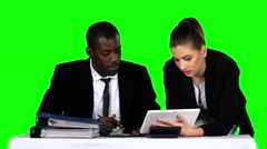 Business people working together while looking at charts in laptop in an office Arkistovideo