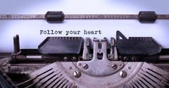 Vintage typewriter - Follow your Heart message - stock photo