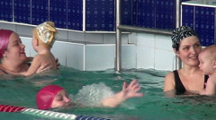 Mothers teach  children to swim. - stock footage