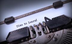 Vintage typewriter - Time to learn - stock photo