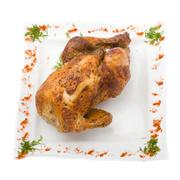 baked fried chicken carcass isolated on white - stock photo