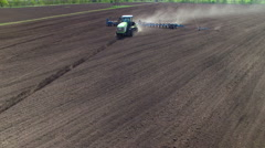 Tractor in the field sow sunflower - stock footage