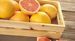 Fresh ruby red grapefruits in wood crate. - stock footage