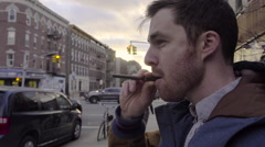 Portrait of a man smoking an e cigarette Stock Footage