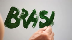 Hand Painting The Word Brasil in Green Gouache Stock Footage