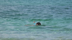 Young man snorkeling in shallow waters of the sea Stock Footage