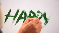 Hand Painting The Word Happy in Green Gouache Stock Footage