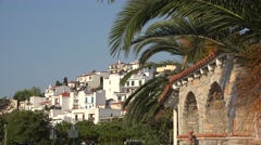 Mediterranean traditional white houses and palm trees Stock Footage