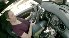 Woman texting and driving slams on her brakes - stock footage