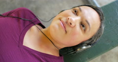 Woman listening to music dutch angle Stock Footage