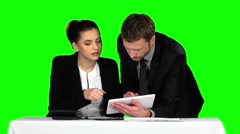 Business man and woman using laptop in office lobby. Green screen Arkistovideo