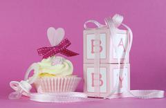 Pink theme baby girl cupcake and favor gift boxes - stock photo