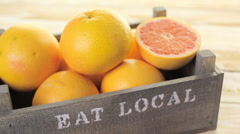 Fresh ruby red grapefruits in wood crate. Stock Footage