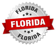 Florida  round silver badge with red ribbon - stock illustration