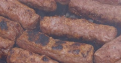 Meat on barbecue close up macro shot serbian food Stock Footage
