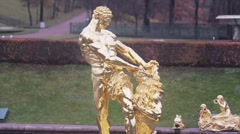View of golden figure of Samson in Peterhof State museum Reserve. Autumn day Stock Footage