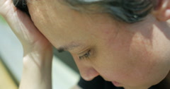 Depressed woman extreme close up Stock Footage