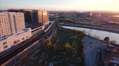 Flushing Meadows Queens Sunset Flyby Viewing The Train & Traffic - stock footage