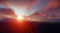 Beautiful sunrise over clouds and ocean, godrays Stock Footage