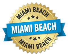 Miami Beach round golden badge with blue ribbon - stock illustration