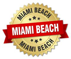 Miami Beach round golden badge with red ribbon - stock illustration