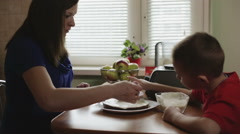 Mother and son making a cake Stock Footage