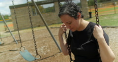Sad woman on a swing medium shot Stock Footage