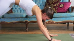 Young Attractive Female Doing A Downward Dog Stretch On A Yoga Mat Stock Footage