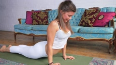 Young Attractive Female Doing A Pose On A Yoga Mat Stock Footage