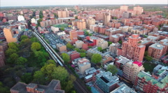 Flushing Meadows Queens Slow Panning Aerial Viewing Buildings & Trees & Train - stock footage