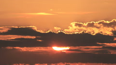 Sunrise timelapse. Sun rising through clouds. Time lapse Stock Footage