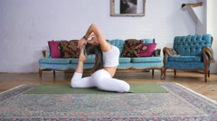 Young Attractive Female Doing A King Pigeon Pose On A Yoga Mat Stock Footage