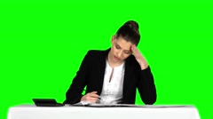Businesswoman overwhelmed by too much paperwork in office. Green screen Stock Footage