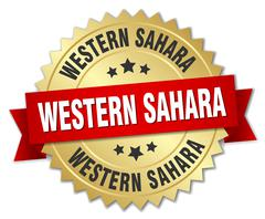 Western Sahara round golden badge with red ribbon - stock illustration